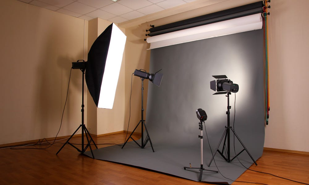9b042bc963de Backdrop with studio lighting and equipment