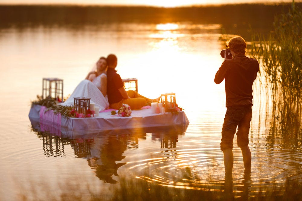 Wedding Photography Shooting Couple On A Raft During Sunset