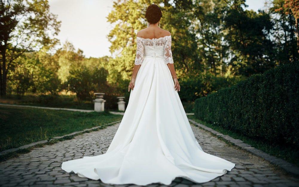 Photographie de mariage de la robe de mariée mariée