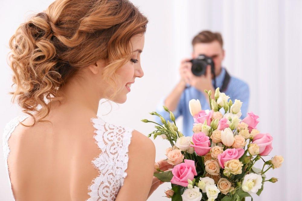 Photographe de mariage photographier la mariée