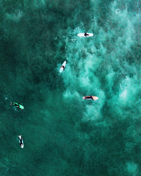 Surfers In Greenish Blue Water Drone Photography