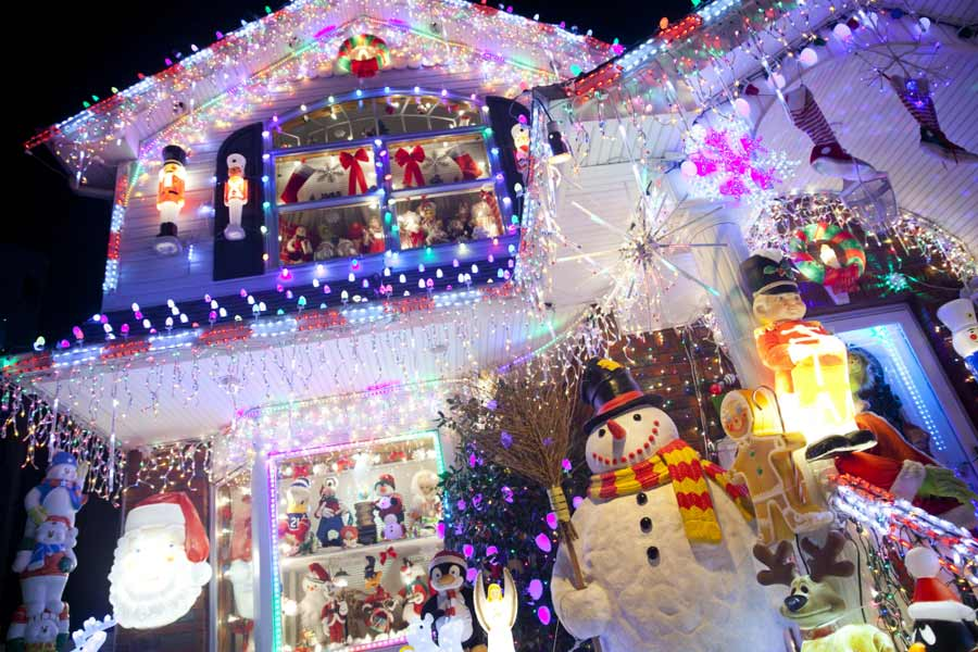 Facade of house with abundant holiday decor and christmas lights