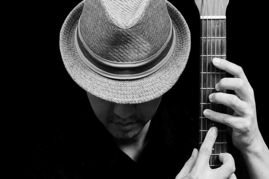Ideas For Creative Faceless Portraits Portrait Of Man Looking Down And Playing The Guitar