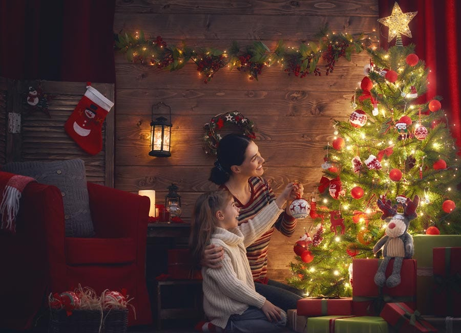 fc3072ce48e3 Mother and daughter adding final touches to the Christmas tree Image via  Shutterstock