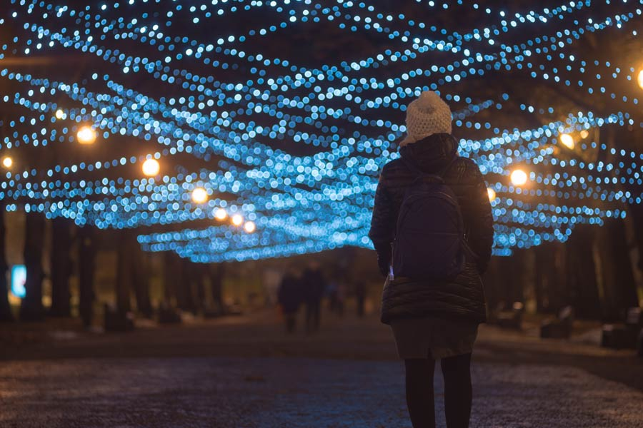 Girl under thousands of blue lights