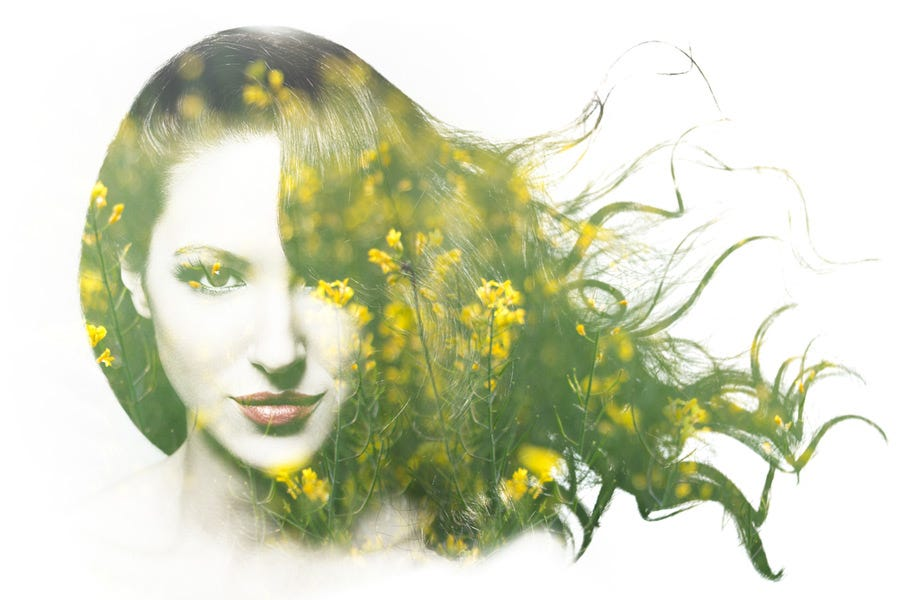 Double exposure of woman and field of yellow flowers