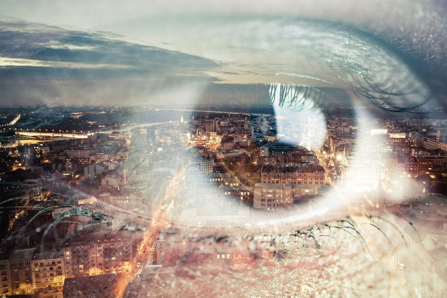 Double Exposure Of Eye And Cityscape