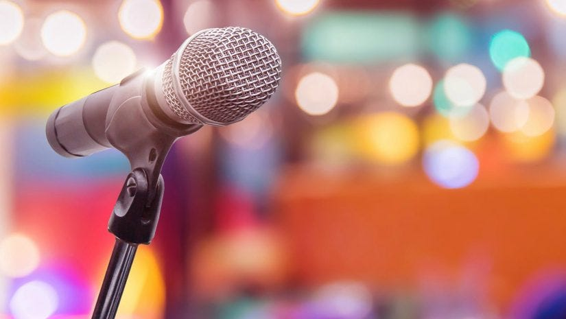 Colorful Bokeh Shot Of Wireless Microphone On Mic Stand