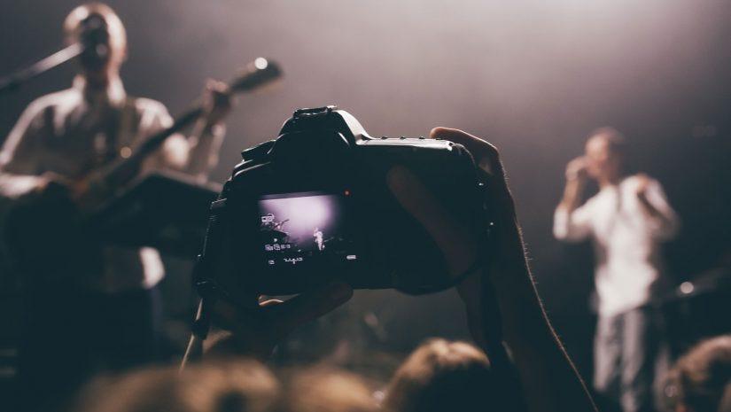 Concert Photographer Shooting Live Performance