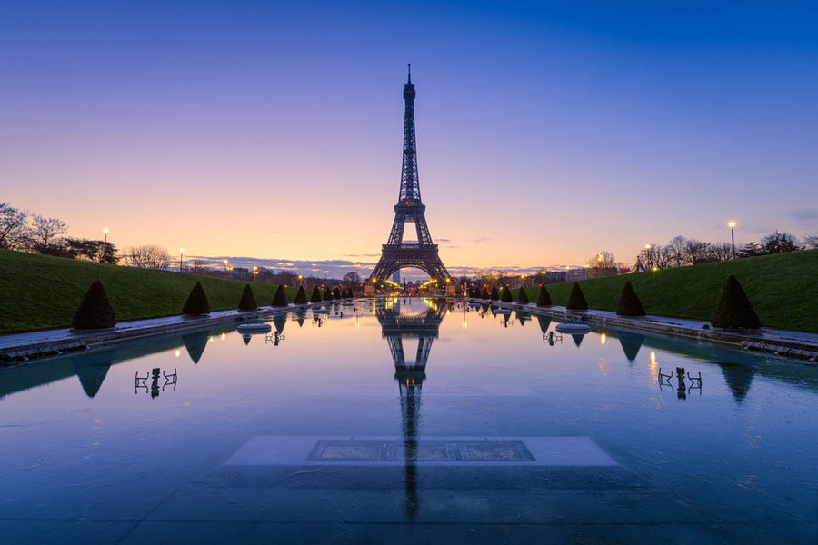 Symmetrical mirror image shot of the Eiffel Tower during the golden hour