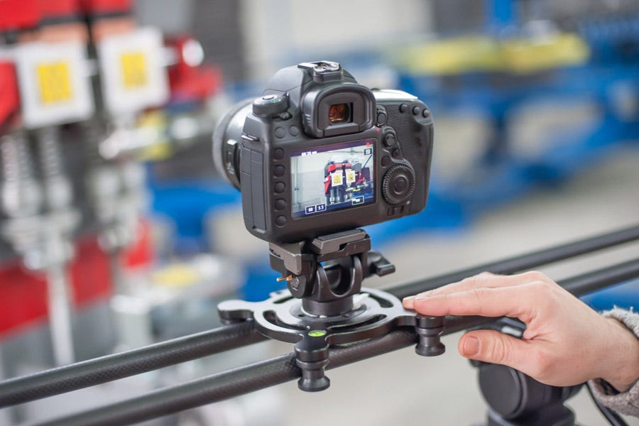 professional video camera on slider