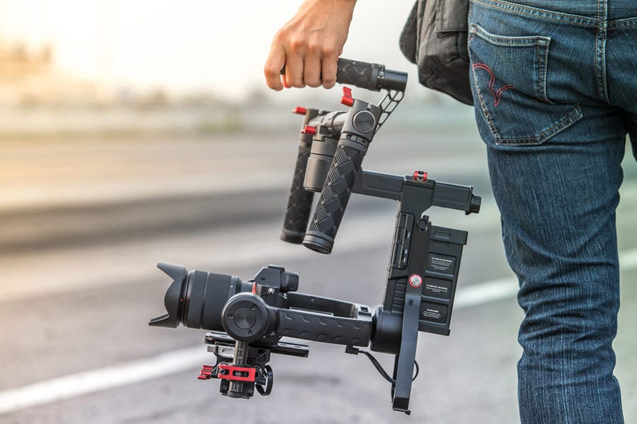 man holding professional video camera rig