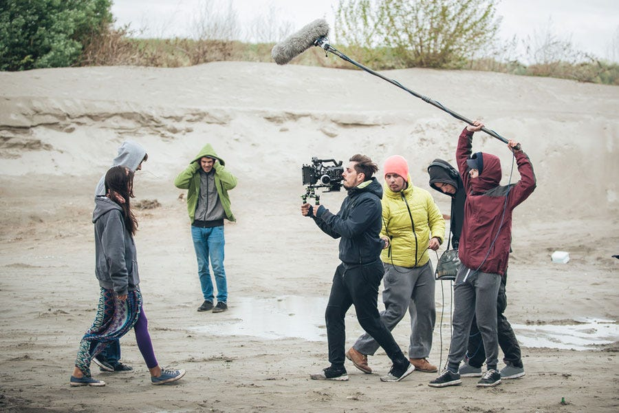 film crew recording outdoors