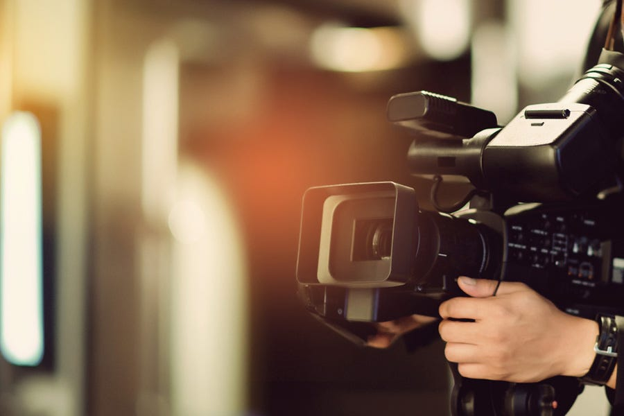 artistic shot of videographer's camera