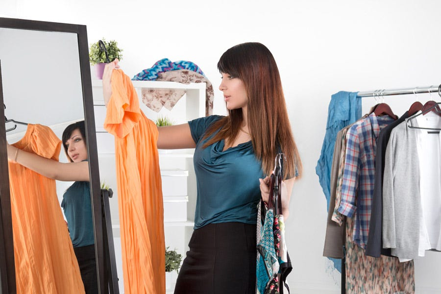 female choosing outfits for model photo shoot
