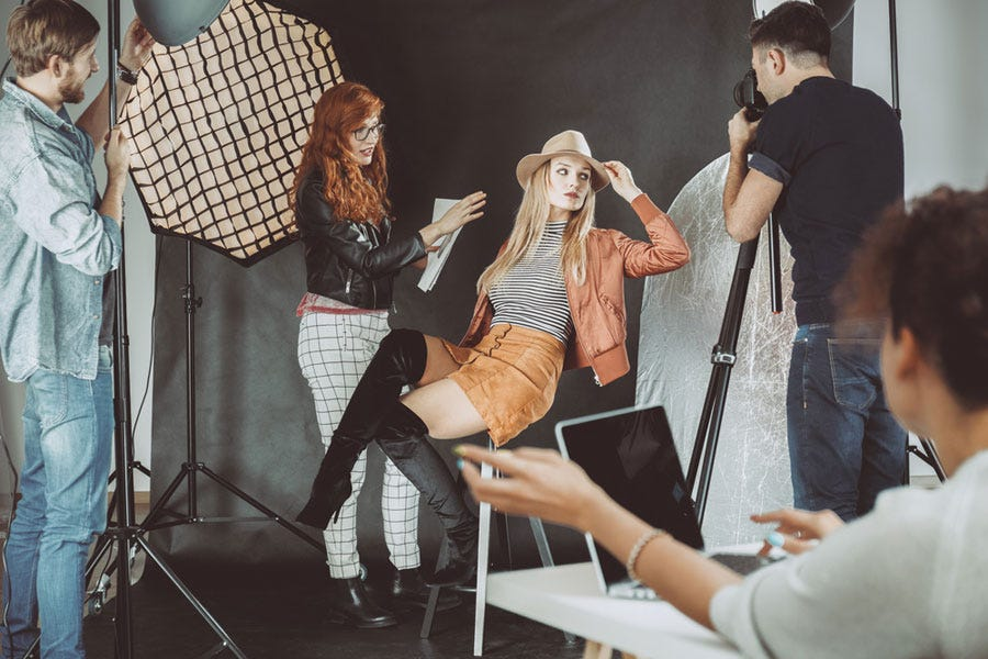 behind the scenes of a model photo shoot