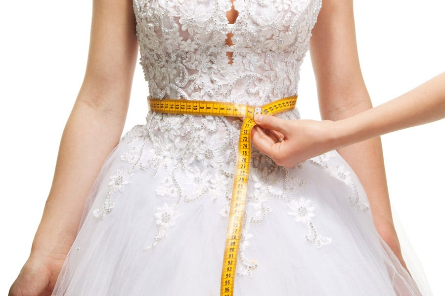 measuring the waist of a fashion model
