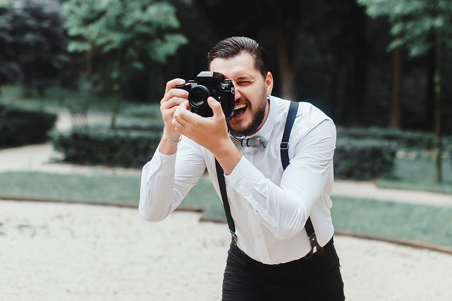 guest shooting a video at a wedding